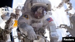 NASA astronaut Peggy Whitson is seen during a spacewalk outside the International Space Station. Whitson is to return to Earth Saturday as the American astronaut with the most time in space, 665 days.