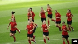 United States players warm up during a training session in preparation for the final match against Japan for the Women's Soccer World Cup Final in Frankfurt, Germany, July 16, 2011