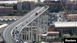 The collapsed Morandi Bridge is seen in the Italian port city of Genoa, Italy, August 16, 2018.