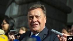 FILE - Ljubljana mayor and opposition leader Zoran Jankovic talks to the media in front of the city hall in Ljubljana, Slovenia.