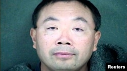 FILE - Zhang Weiqiang is shown in this Wyandotte County, Kansas, Detention Center handout photo released to Reuters Dec. 12, 2013. Zhang is one of two agricultural scientists from China who were charged with trying to steal samples of a variety of seeds from a biopharmaceutical company's research facility in Kansas, said Barry Grissom, spokesman for the U.S. attorney for the District of Kansas.