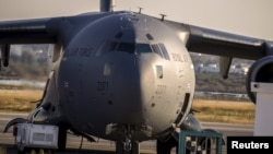 FILE - A Royal Air Force (RAF) C17 plane is seen on the tarmac ready to transport British tourists, who were wounded during the Imperial Marhaba hotel attack by a gunman, in Monastir airport, Tunisia, June 29, 2015.