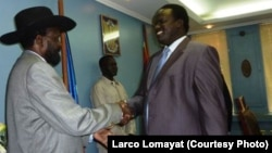South Sudanese President Salva Kiir congratulates Joseph Montuel after naming him governor of Unity state.