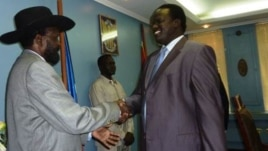 South Sudanese President Salva Kiir congratulates Joseph Montuel after naming him governor of Unity state.