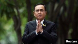 Thailand's Prime Minister Prayuth Chan-ocha gestures while speaking to media members at the Government House in Bangkok, Thailand June 6, 2019.