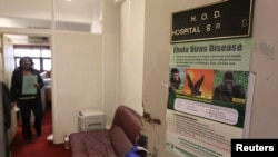 Poster providing information on the Ebola virus on the door of the Head of Department of Hospital Services, Federal Ministry of Health, Abuja, Aug. 11, 2014.