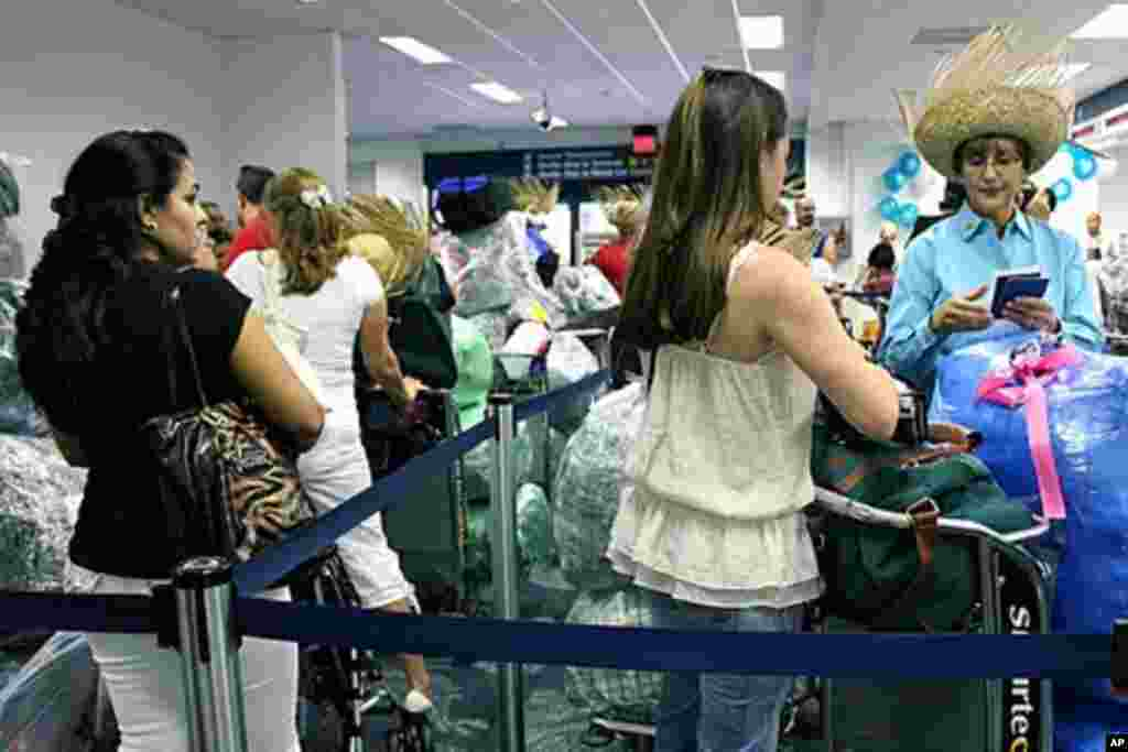 More than 100 passengers wait to check in for the first flight from Fort Lauderdale to Cuba since 1987. More U.S. airports are now offering charter flights to Cuba after the Obama administration loosened travel restrictions in January.