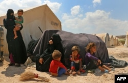 Displaced Syrians are seen at a camp in Kafr Lusin near the Bab al-Hawa border crossing with Turkey in the northern part of Syria's rebel-held Idlib province on Sept. 6, 2018.