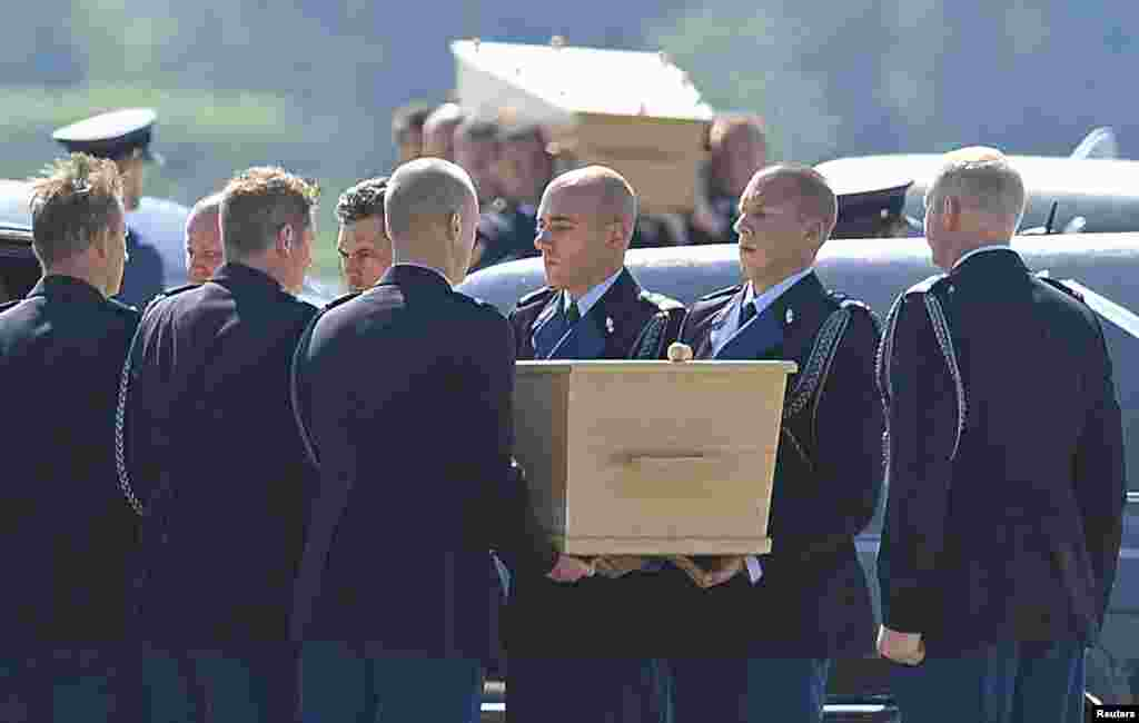 Coffins of the victims of Malaysia Airlines MH17 downed over rebel-held territory in eastern Ukraine are loaded into hearses during a national reception ceremony at Eindhoven Airport, Netherlands, July 23, 2014.