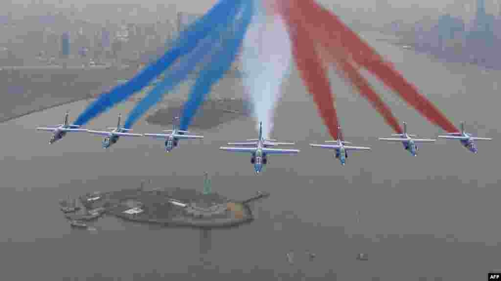 This handout framegrab taken by the French Air Force shows La Patrouille de France alphajets flying over the Statue of Liberty, as part of a 6-week tour of the U.S., in New York, March 25, 2017.