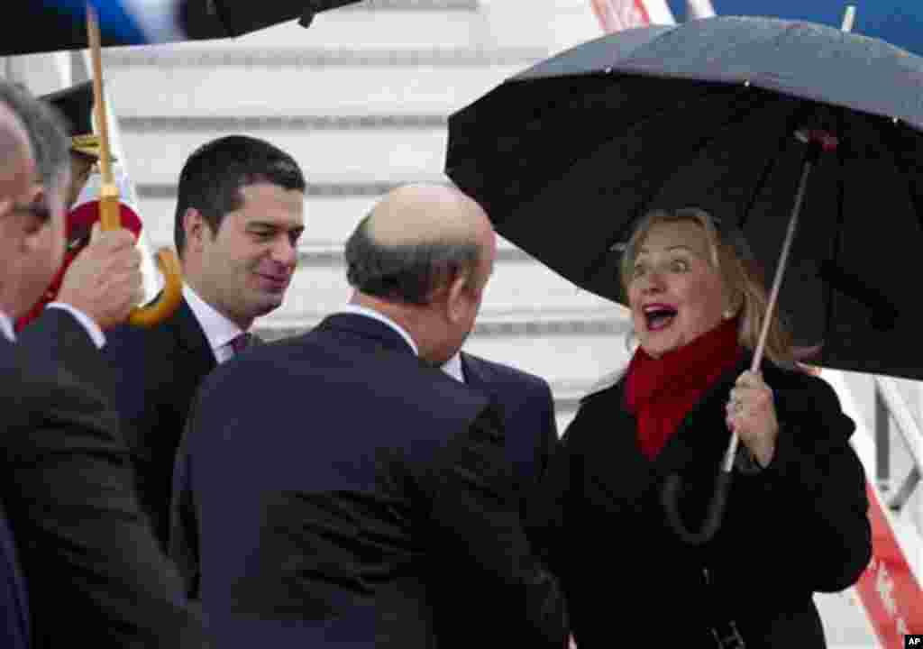 US Secretary of State Hillary Clinton is greeted by officials as she disembarks from her plane upon arrival at Tirana Rinas Airport in Tirana, Thursday, Nov. 1, 2012. Hillary Clinton arrived in EU-hopeful Albania on the last leg of her Balkans tour where