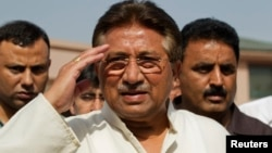 FILE - Pakistan's former President and head of the All Pakistan Muslim League (APML) political party Pervez Musharraf salutes as he arrives to unveil his party manifesto for the general election in Islamabad.