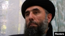 FILE - Gulbuddin Hekmatyar speaks to a reporter in 2007.