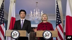 Secretary of State Hillary Clinton (R) speaks during a meeting with Japanese Foreign Minister Koichiro Gemba (L) at the State Department in Washington, December 19, 2011