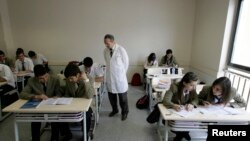 FILE - Children attend a class at Fatih College in Istanbul, Turkey. The 640-pupil school is run by followers of Fethullah Gulen.
