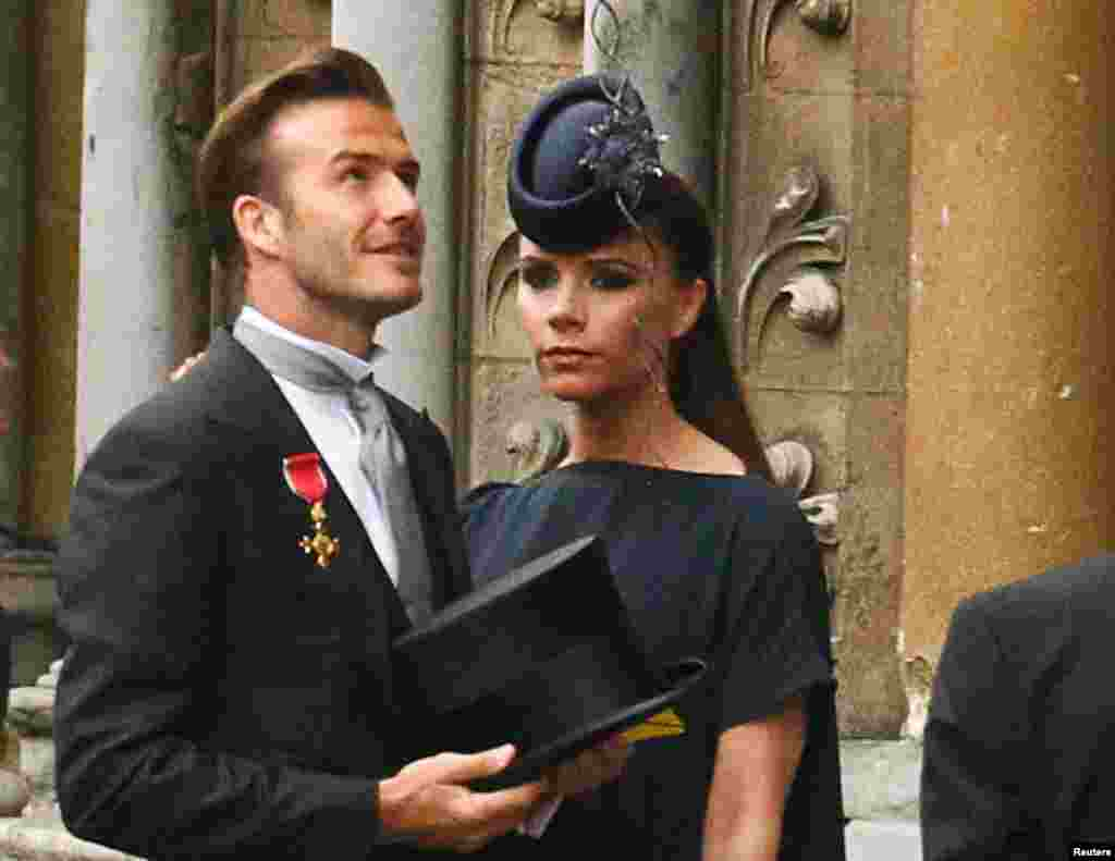 The Beckhams arrive at Westminster Abbey before the wedding of Britain's Prince William and Kate Middleton, in London April 29, 2011.