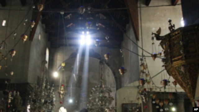 In this photo taken Monday, Nov. 14, 2011, pilgrims and tourists visit the Church of the Nativity, believed by many to be the birthplace of Jesus Christ, in the West Bank city  of Bethlehem.