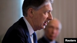 British Foreign Secretary Phillip Hammond, left speaks during a joint news conference with Pakistan Foreign Affairs Adviser Sartaj Aziz at the Foreign Ministry in Islamabad, Pakistan, March 8, 2016.
