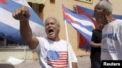 Anti-Castro activist protests in Little Havana in Miami, Florida, July 20, 2015.
