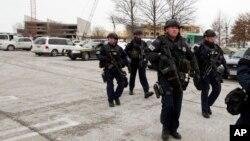 La police sur les lieux de la tuerie dans le centre commercial de Columbia, Maryland, aux Etats-Unis