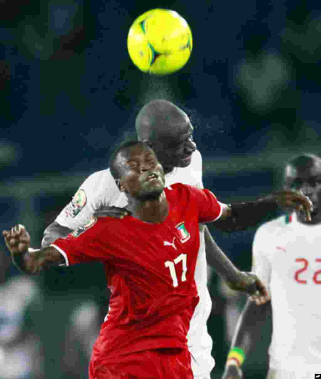 Ekanga of Equatorial Guinea challenges N'Daw of Senegal during their African Nations Cup Group A soccer match at Estadio de Bata