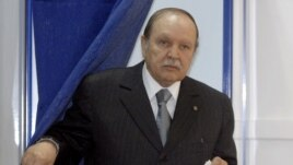 FILE - This May, 10, 2012, file photo shows Algerian President Abdelaziz Bouteflika exiting a parliamentary election voting booth in Algiers.
