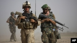 A U.S. Marine and an Afghan soldier are seen on joint patrol in Helmand province, southern Afghanistan (file photo).