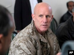 Then-Vice Admiral Robert S. Harward, commanding officer of Combined Joint Interagency Task Force 435, speaks to an Afghan official during his visit to Zaranj, Afghanistan, Jan 6, 2011.