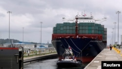 A floating gate is opening to the Chinese COSCO container vessel named Andronikos navigating through the Agua Clara locks during the first ceremonial pass through the newly expanded Panama Canal in Agua Clara, on the outskirts of Colon City, Panama June 2