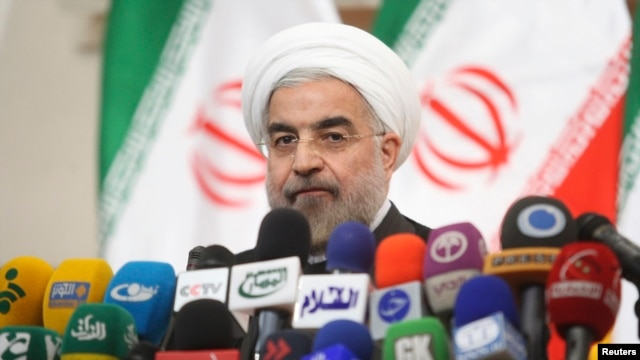 FILE - Hassan Rouhani, in this image still president-elect, speaks with the media during a news conference in Tehran June 17, 2013.