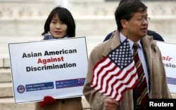 FILE - Asian-American demonstrators rally outside the U.S. Supreme Court as it was hearing a case involving affirmative action in university admissions, Dec. 9, 2015.