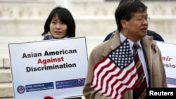 FILE - Asian-American demonstrators hold a rally outside the U.S. Supreme Court as it was hearing a case involving affirmative action in university admissions, Dec. 9, 2015. (REUTERS/Kevin Lamarque)