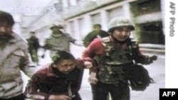 Người biểu tình Tây Tạng bị rượt đuổi