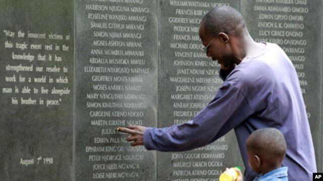 A survivor pays homage at the memorial wall with the names of 248 people killed in the 1998 bombing of the U.S.embassy are seen on the memorial wall in Nairobi. Al Qaeda leader Osama bin Laden was killed in a U.S. helicopter raid on a mansion near the Pak