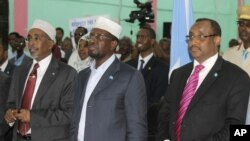 Somali president Sharif Sheik Ahmed, center, Prime Minister, Abdiwali Mohamed Ali, right, and parliament speaker Sharif Hassan Sheik Adan, left, during constituent assembly opening in Mogadishu, July 25, 2012.