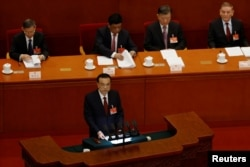Description: Chinese Premier Li Keqiang speaks at the opening session of the National People's Congress (NPC) at the Great Hall of the People in Beijing, China March 5, 2021.