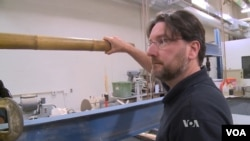 Professor Kent Harries of the University of Pittsburgh is testing bamboo. He wants standardized tests for its use as a building material. (Credit Adam Greenbaum, VOA News)