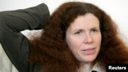 FILE - Russian journalist Yulia Latynina speaks during an interview with Reuters in Moscow.