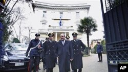 Greek ambassador to Italy Michael E. Cambanis (2nd R) is flanked by Carabinieri officers as he walks off the Greek Embassy in Rome, 27 Dec 2010