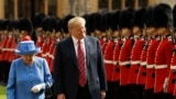 U.S. President Donald Trump and Britain's Queen Elizabeth II inspect a Guard of Honour, formed of the Coldstream Guards at Windsor Castle in Windsor, England.