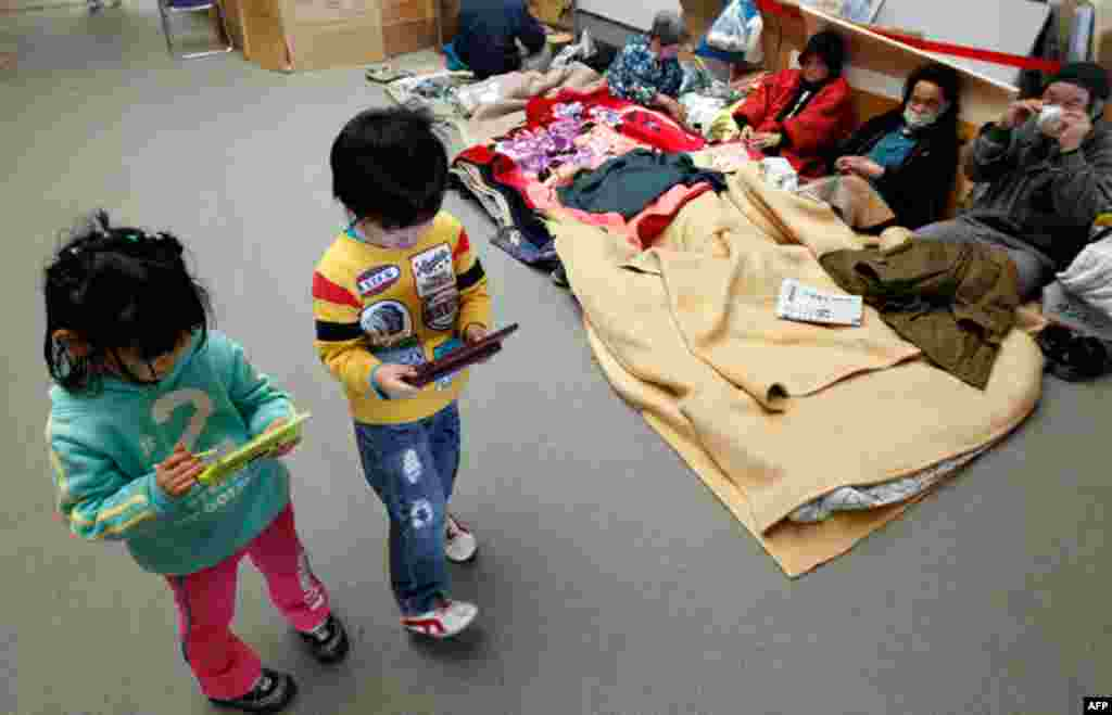 March 29: Children play with game consoles at an evacuation center in Koriayama, northern Japan. (Reuters/Kim Kyung-Hoon)