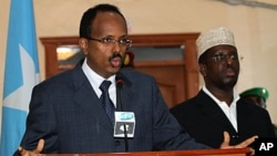 Somalia's Prime Minister Mohamed Abdullahi Mohamed speaking in the capital, Mogadishu, Sunday, June 19, 2011