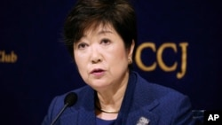 FILE - In this Feb. 18, 2019, file photo, Governor of Tokyo Yuriko Koike speaks during a press conference in Tokyo. Sapporo officials are thrilled with a proposal to move next year's Tokyo Olympic marathons to the northern Japanese city to avoid the summer heat in the city.