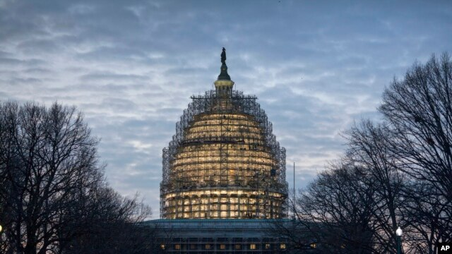 FILE - The Capitol Dome in Washington is illuminated early on Jan. 12, 2016, the day of President Barack Obama's final State of the Union address before Congress in Washington.