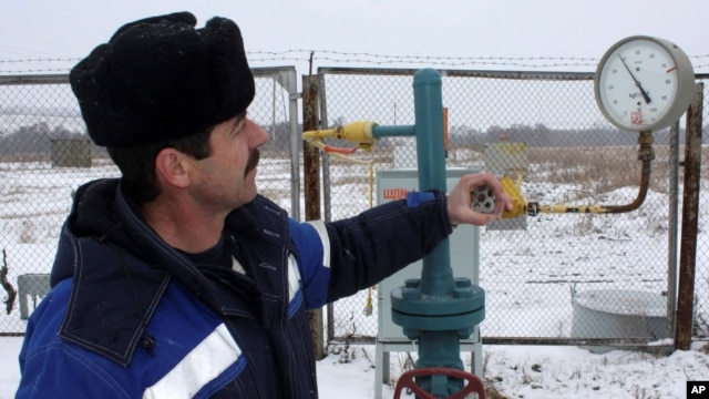 FILE - A technician inspects pipeline equipment and gas pressure at the gas metering station in Pisarevka, Russia, on the border with Ukraine.
