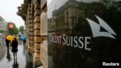 FILE - Swiss bank Credit Suisse's logo is seen in front of its headquarters in Zurich.