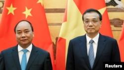 9月12日中國總理李克強(右)和越南總理阮春福在北京出席簽字儀式。