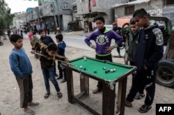 Palestinian boys play pool in the Rafah refugee camp in the southern Gaza Strip.