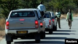 FILE - Zimbabwean policemen are seen stopping a group of cars on the outskirts of Mawabeni, Zimbabwe, June 6, 2008.