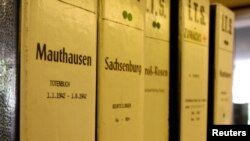 Folders containing original documents like necrologies of prisoners of the former concentration camps are seen at the International Tracing Service (ITS) in the central German town of Bad Arolsen, May 10, 2006.